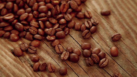 Coffee beans on wood background Footage