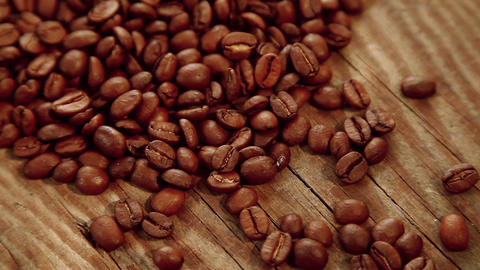 Coffee beans on wood background Stock Video Footage