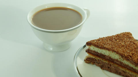 Cup of coffee with milk and piece of cake Stock Video Footage