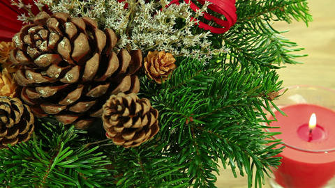 Christmas decoration with tree branch and candle Stock Video Footage