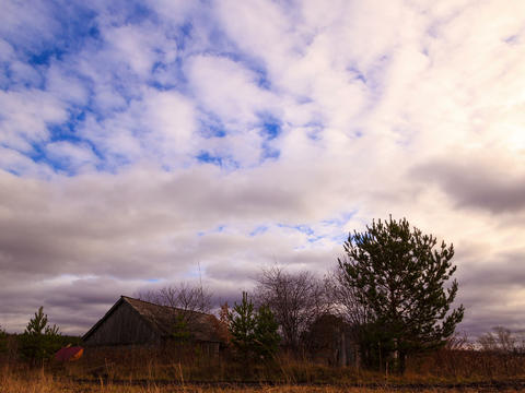 Clouds sweep over the barn. Time Lapse. 4x3 Stock Video Footage