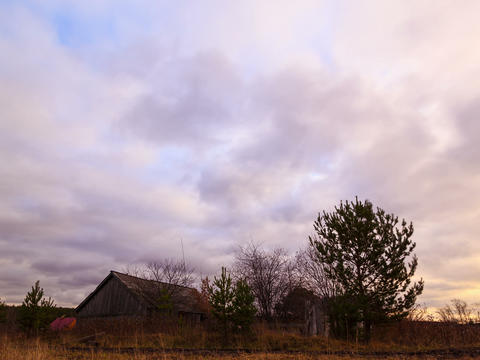 Clouds sweep over the barn. Time Lapse. 4x3 Footage