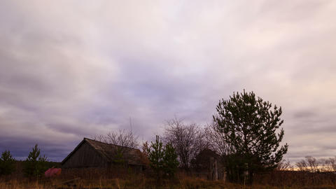 Clouds sweep over the barn. Time Lapse. 4K Stock Video Footage