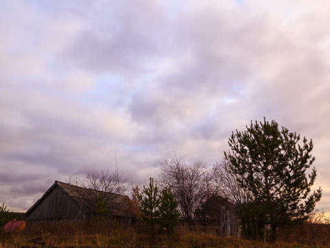 Clouds sweep over the barn. Time Lapse Footage