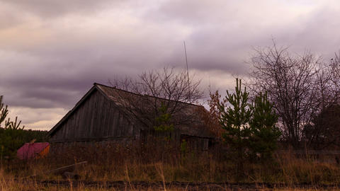 Clouds sweep over the barn. Time Lapse Stock Video Footage
