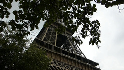 PANNING FROM TOP TO LOWER PART OF PARIS EIFFEL TOWER... Stock Video Footage