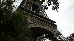 PANNING FROM TOP TO LOWER PART OF PARIS EIFFEL TOWER (PARIS EIFFEL TOWER--2) stock footage