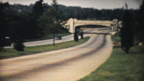 Cars Driving Down Toll Highway in 1940 Stock Video Footage