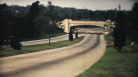 Cars Driving Down Toll Highway in 1940 Footage