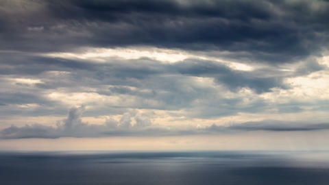 Sun beams over sea time lapse Stock Video Footage