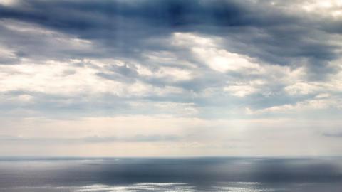 Sun beams over sea time lapse Footage