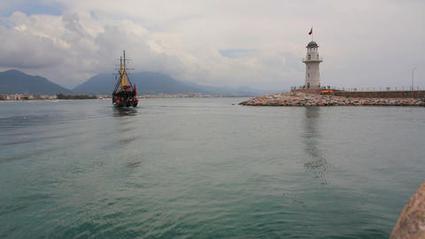 ship with tourists go out of bay - Alanya Turkey Stock Video Footage