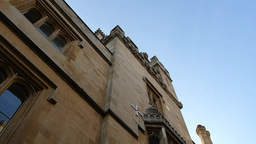 Pan from roof to a quiet street level of Oxford. ( Stock Video Footage