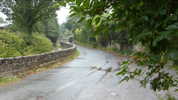 A curve road with low stonewall at Gittisham(A CUR Stock Video Footage