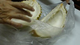 Close-up of opening up a durian Stock Video Footage