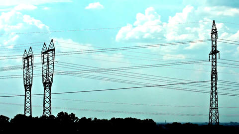 electrical towers and cloudy sky Stock Video Footage