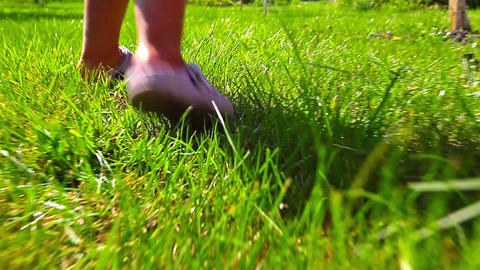 girl running on green grass Stock Video Footage