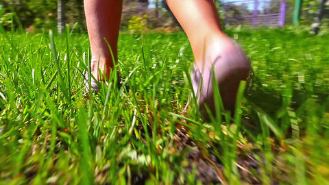 girl running on green grass Footage