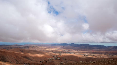 4k UHD low time lapse clouds over valley 11187 Stock Video Footage