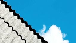 clouds rushing across the sky over the roof line o Stock Video Footage