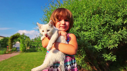 Little Girl Play With Cat In Green Garden stock footage