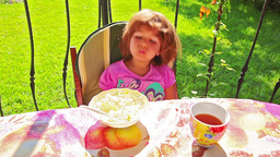 Little girl eating cottage cheese Footage