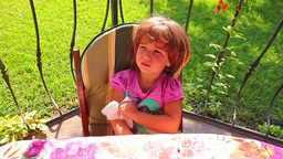 Little girl eating cottage cheese Stock Video Footage