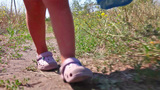 Girl Walking Along The Road stock footage