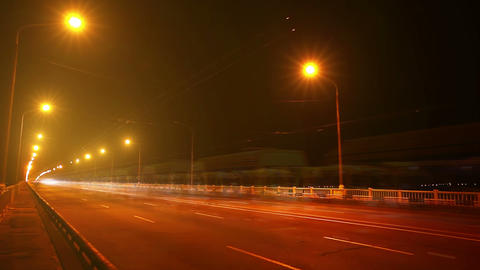 Timelapse of traffic on bridge at night. Blurred m Stock Video Footage