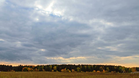 Rays of sun on a background autumn landscape. 4K Footage