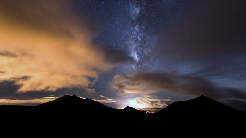 4k UHD milky way clouds traffic in mountain pan Stock Video Footage