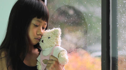 Asian Girl Comforted By Teddy Bear Stock Video Footage