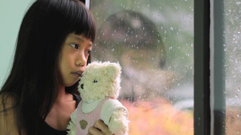 Asian Girl Comforted By Teddy Bear Footage