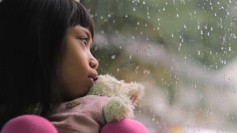 Depressed Little Asian Girl By The Window Stock Video Footage