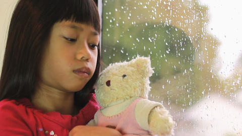 Sad Asian Girl Is Comforted By Teddy Bear Stock Video Footage