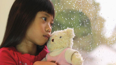 Sad Asian Girl Is Comforted By Teddy Bear Footage