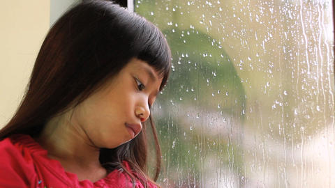 Sad Asian Girl Sits By Rainy Window Footage