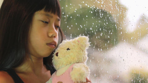 Sad Seven Year Old Asian Girl By Window Stock Video Footage