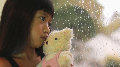 Sad Seven Year Old Asian Girl By Window Footage
