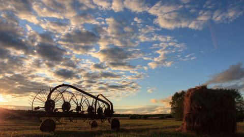 Tractor rake at sunset. Time Lapse Footage