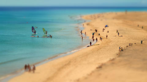 4k UHD Human Ants Beach Walk Tilt Shift Pan 11219 stock footage