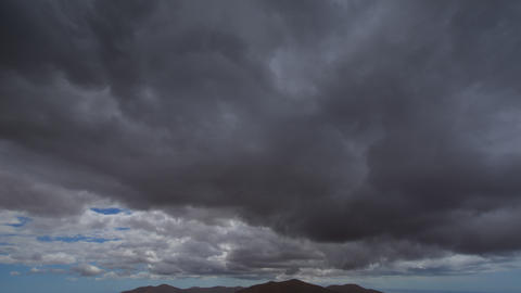 4k UHD extreme dark storm clouds to sun time 11223 Stock Video Footage