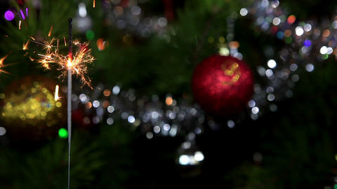 Christmas tree, mirror ball and lit sparkler, FULL Live Action