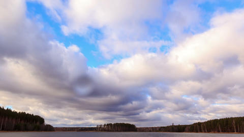 Rain clouds over the pond. Time Lapse Footage