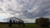Tractor Rake On A Background Of Clouds. Time Lapse stock footage