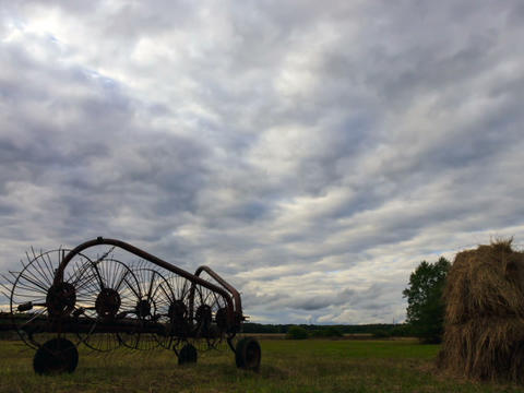 Tractor rake on a background of clouds. Time Lapse Footage