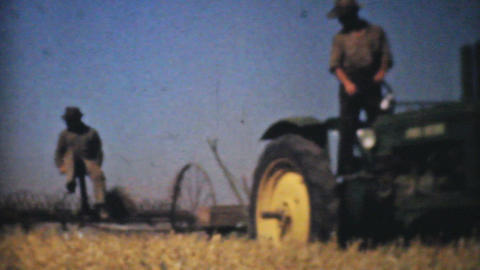 Farmers Harvesting Fields With Tractors 1940 Vinta stock footage