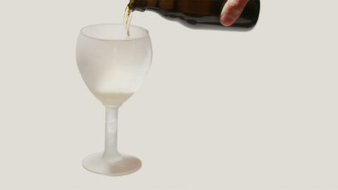Pouring Glass With Beer Isolated On Grey Backgroun stock footage