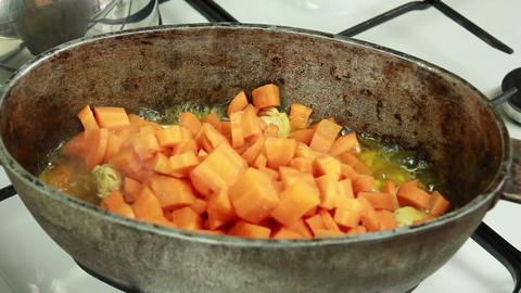 Chief Adding Sliced Carrot And Mixing With Meat In stock footage