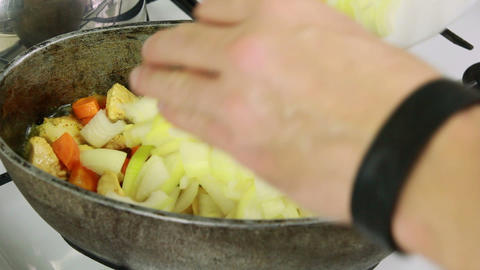 Kitchener adding onion in kettle with simmering in Stock Video Footage